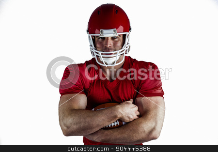American football player with ball stock photo, American football player with ball on white background by Wavebreak Media