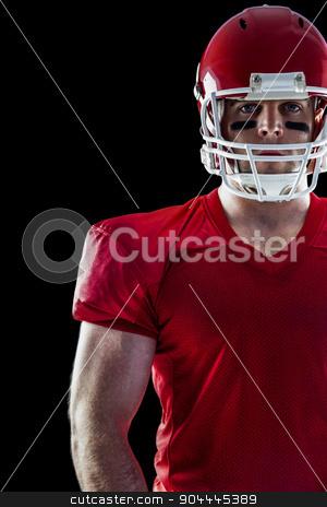 American football player looking at camera stock photo, American football player looking at camera on black background by Wavebreak Media