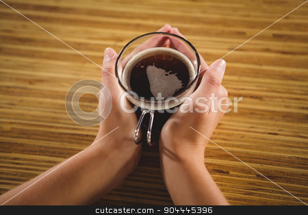 Womans hands holding cup of coffee stock photo, Womans hands holding cup of coffee at coffee shop by Wavebreak Media