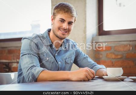 Handsome man having cup of coffee stock photo, Portrait of handsome man having cup of coffee at coffee shop by Wavebreak Media