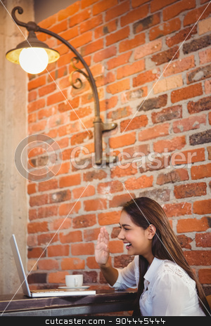 Businesswoman having coffee and working on laptop stock photo, Businesswoman having coffee and working on laptop in a cafe by Wavebreak Media