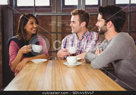 Group of friends enjoying a breakfast stock photo, Group of friends enjoying a breakfast in a cafe by Wavebreak Media