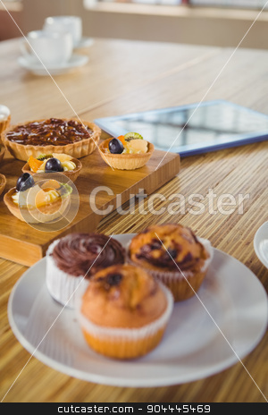 Pies on a wooden table stock photo, Pies on a wooden table in a cafe by Wavebreak Media
