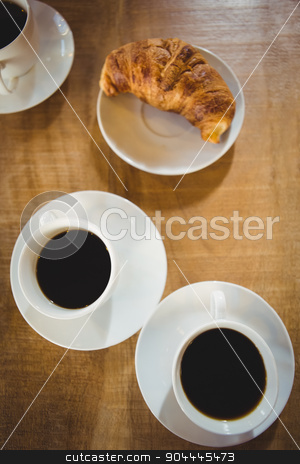 Cups coffee with croissant  stock photo, Cups coffee with croissant on a wooden table by Wavebreak Media