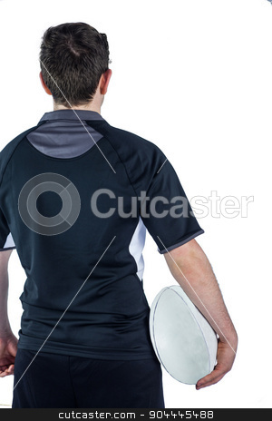 Back turned rugby player holding a ball stock photo, Back turned rugby player holding a ball on a white background by Wavebreak Media