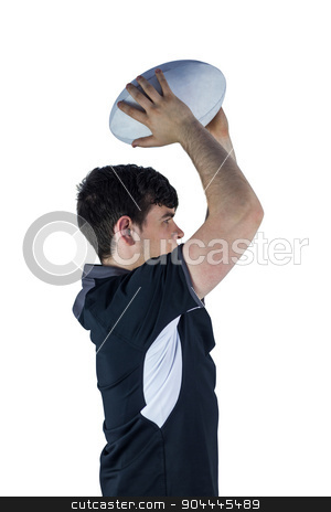 Profile view of rugby player throwing a ball stock photo, Profile view of rugby player throwing a ball on a white background by Wavebreak Media