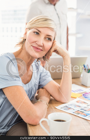 A thoughtful businesswoman looking away stock photo, A thoughtful businesswoman looking away in the office by Wavebreak Media