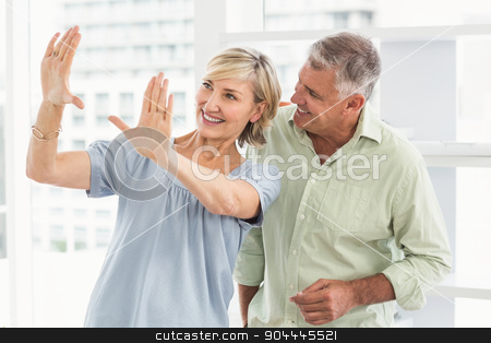 Smiling businesswoman gesturing with hands stock photo, Smiling businesswoman gesturing with hands at the office by Wavebreak Media