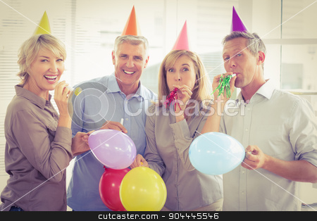 Casual business people celebrating birthday stock photo, Portrait of casual business people celebrating birthday in the office by Wavebreak Media