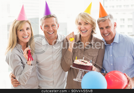 Happy casual business people celebrating birthday stock photo, Portrait of happy casual business people celebrating birthday in the office by Wavebreak Media