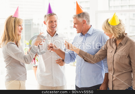 Casual business people making birthday toasts stock photo, Casual business people making birthday toasts in the office by Wavebreak Media