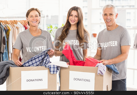 Concerned business people with donation boxes stock photo, Portrait of concerned business people with donation boxes in the office by Wavebreak Media