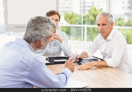 Business people talking and making arrangements stock photo, Business people talking and making arrangements in the office by Wavebreak Media
