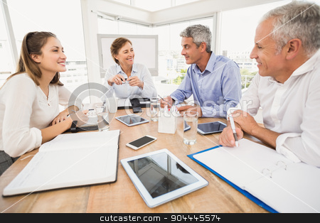 Smiling business people having a meeting stock photo, Smiling business people having a meeting in the office by Wavebreak Media