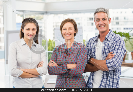 Smiling casual business people with arms crossed stock photo, Portrait of smiling casual business people with arms crossed in the office by Wavebreak Media
