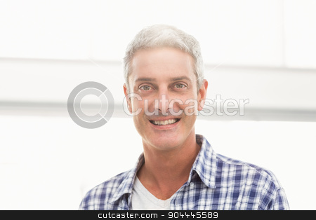 Smiling casual businessman stock photo, Portrait of smiling casual businessman in the office by Wavebreak Media