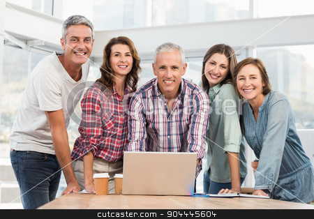 Five casual colleagues using laptop stock photo, Five casual colleagues using laptop in the office by Wavebreak Media