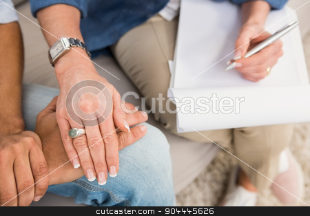 Close up view of therapist comforting male patient stock photo, Close up view of therapist comforting male patient in the office by Wavebreak Media