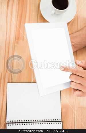 Hands holding blank screen tablet stock photo, Hands holding blank screen tablet on wooden desk by Wavebreak Media
