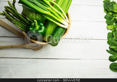 Green vegetables on table stock photo, Green vegetables on table shot in studio by Wavebreak Media
