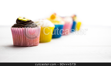 Delicious cupcakes on a table stock photo, Delicious cupcakes on a table shot in studio by Wavebreak Media