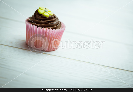 Delicious cupcake on a table stock photo, Delicious cupcake on a table shot in studio by Wavebreak Media
