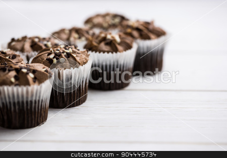 Chocolate cupcakes on a table stock photo, Chocolate cupcakes on a table shot in studio by Wavebreak Media