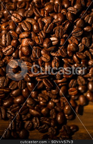 Coffee beans on a table stock photo, Coffee beans on a table shot in studio by Wavebreak Media