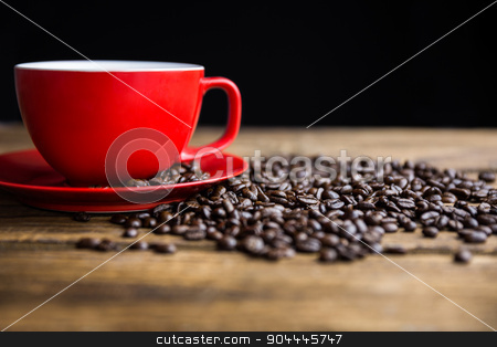 Coffee beans on a table with cup stock photo, Coffee beans on a table with cup shot in studio by Wavebreak Media