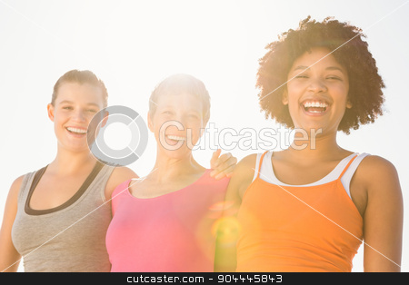 Sporty women laughing at camera stock photo, Portrait of sporty women laughing at camera at promenade by Wavebreak Media