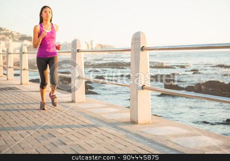 Fit woman jogging at promenade stock photo, Fit woman jogging at promenade on a sunny day by Wavebreak Media