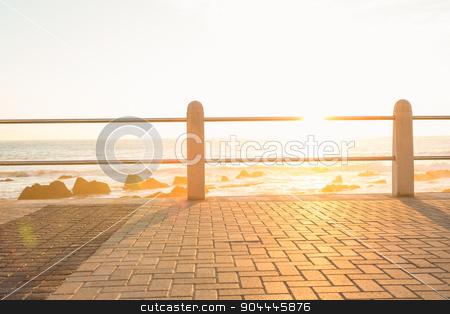 Railing on a promenade stock photo, Railing on a promenade against sunset by Wavebreak Media