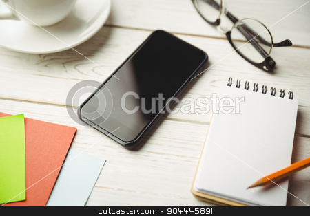 View of an desk stock photo, View of an desk with mobile phone by Wavebreak Media