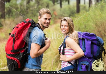 Portrait of a smiling hiker couple  stock photo, Portrait of a smiling hiker couple  in the nature by Wavebreak Media
