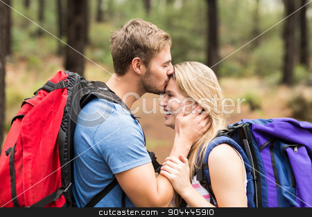 Young happy hiker couple kissing stock photo, Young happy hiker couple kissing in the nature by Wavebreak Media