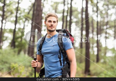 Young handsome hiker looking away stock photo, Young handsome hiker looking away in the nature by Wavebreak Media