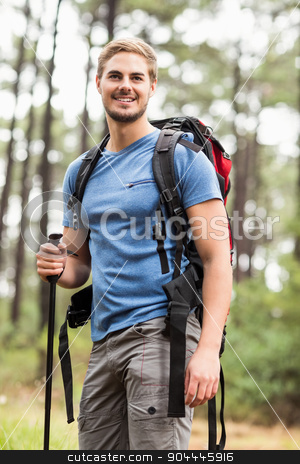 Young handsome hiker looking away stock photo, Young handsome hiker looking away in the nature by Wavebreak Media