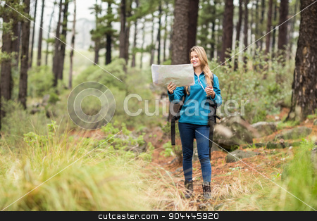 Young pretty hiker using compass and map stock photo, Young pretty hiker using compass and map in the nature by Wavebreak Media