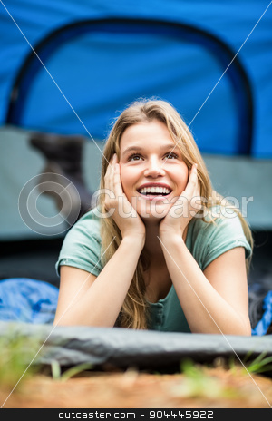 Young pretty hiker lying in a tent stock photo, Young pretty hiker lying in a tent in the nature by Wavebreak Media