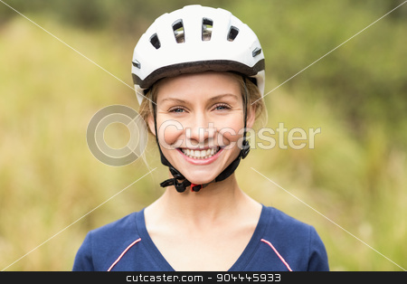 Young pretty happy biker looking at camera stock photo, Young pretty happy biker looking at camera in the nature by Wavebreak Media