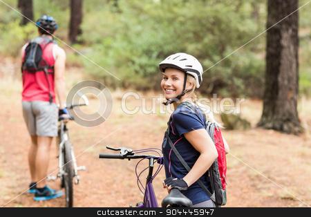 Pretty biker looking at camera stock photo, Pretty biker looking at camera in the nature by Wavebreak Media