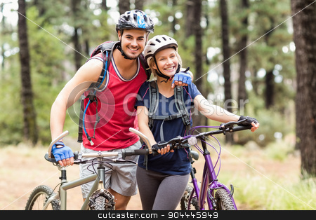 Happy young biker couple looking at camera stock photo, Happy young biker couple looking at camera in the nature by Wavebreak Media