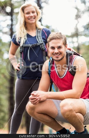 Happy young couple looking at camera stock photo, Happy young couple looking at camera in the nature by Wavebreak Media