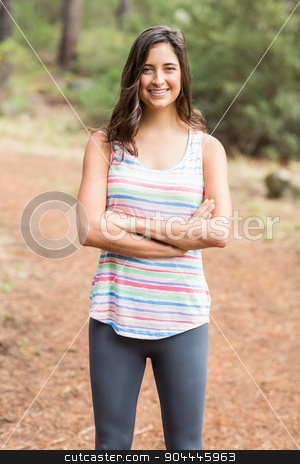 Young happy jogger looking at camera stock photo, Young happy jogger looking at camera in the nature by Wavebreak Media