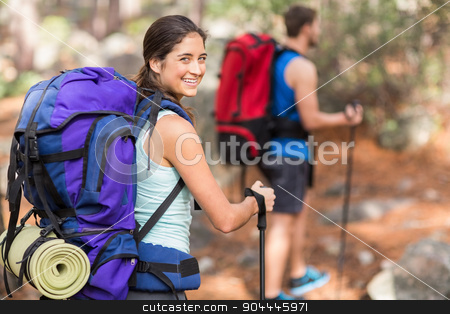 Happy hiker looking at Camera stock photo, Happy hiker looking at Camera in the nature by Wavebreak Media