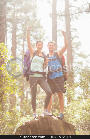 Happy hikers cheering on top of a rock stock photo, Happy hikers cheering on top of a rock in the nature by Wavebreak Media