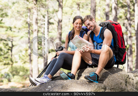 Young happy joggers looking at map stock photo, Young happy joggers looking at map in the nature by Wavebreak Media