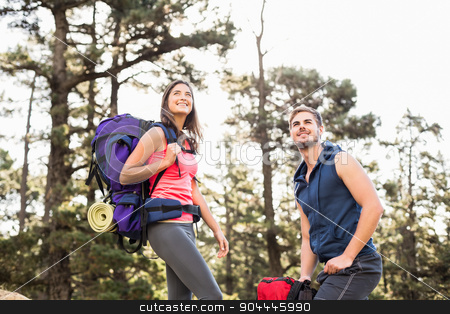 Young happy joggers standing on rock looking away stock photo, Young happy joggers standing on rock looking away in the nature by Wavebreak Media