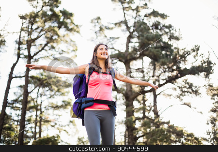 Young happy jogger standing on rock feeling free stock photo, Young happy jogger standing on rock feeling free in the nature by Wavebreak Media