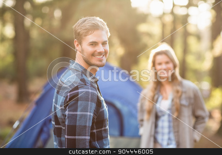 Happy young camper couple smiling stock photo, Happy young camper couple smiling at the camera in the nature by Wavebreak Media